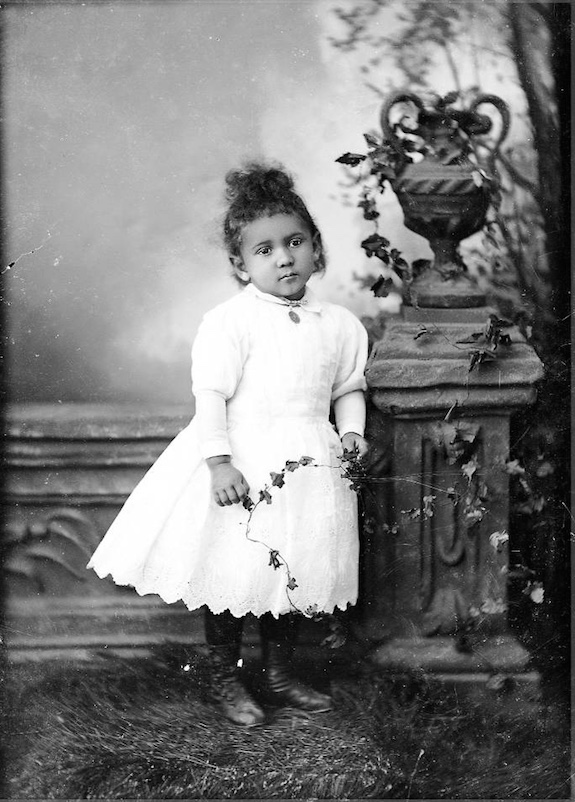 Studio portrait of young African American girl copy