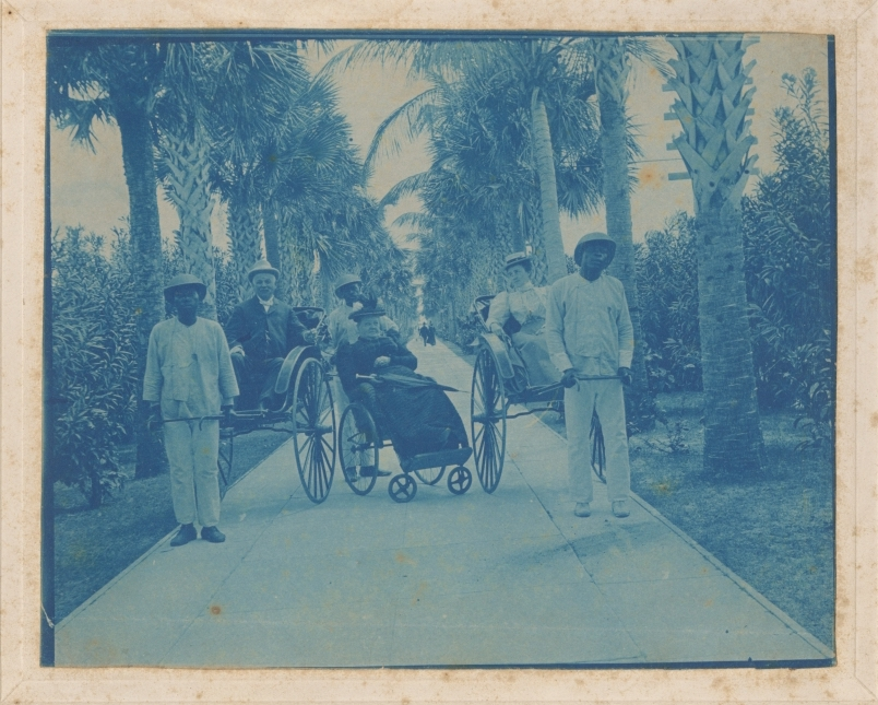 Men Pulling Carts Palm Beach Florida copy